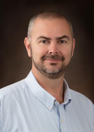 Chris Scruggs,SRES:Senior Real Estate Specialist